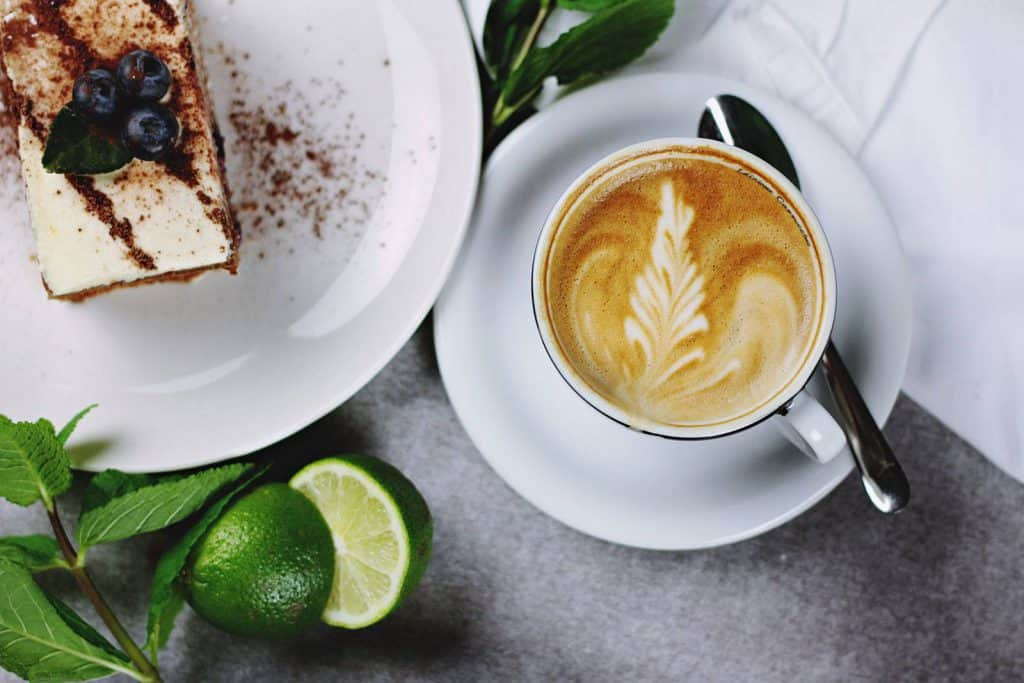 Coffee and cake on a table served in a restaurant