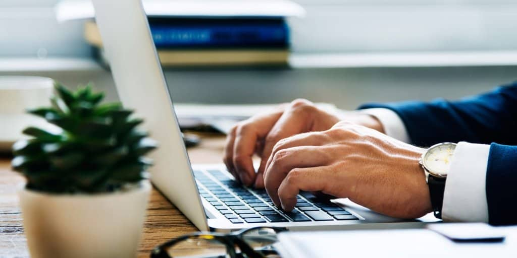 Man working with accounting software on his laptop